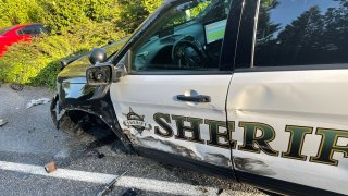"""A damaged Snohomish County, Washington, sheriff's office vehicle after a Tesla allegedly on """"Autopilot"""" struck it as it was parked on Saturday, May 15, 2021."""