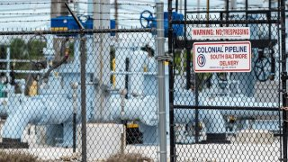 A sign is seen at Colonial Pipeline Baltimore Delivery in Baltimore, Maryland on May 10, 2021. - The US government declared a regional emergency Son May 9, 2021 as the largest fuel pipeline system in the United States remained largely shut down, two days after a major ransomware attack was detected. The Colonial Pipeline Company ships gasoline and jet fuel from the Gulf Coast of Texas to the populous East Coast through 5,500 miles (8,850 kilometers) of pipeline, serving 50 million consumers. The company said it was the victim of a cybersecurity attack involving ransomware -- attacks that encrypt computer systems and seek to extract payments from operators. (Photo by JIM WATSON / AFP) (Photo by JIM WATSON/AFP via Getty Images)