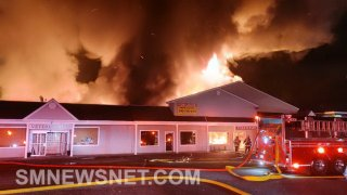 A strip mall engulfed in flames in Solomons, Maryland