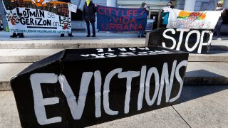 Tenants' rights advocates demonstrate in front of the Edward W. Brooke Courthouse, Wednesday, Jan. 13, 2021, in Boston. The protest was part of a national day of action calling on the incoming Biden administration to extend the eviction moratorium initiated in response to the Covid-19 pandemic.