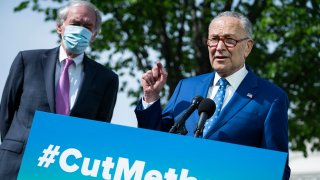 U.S. Senate Majority Leader Sen. Chuck Schumer (D-NY) (L) and Senator Ed Markey (D-MA) participate in a news conference about the Senate vote on methane regulation outside of the U.S. Capitol on April 28, 2021 in Washington, DC.