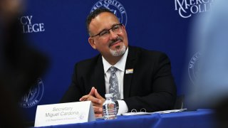 U.S. Secretary of Education Miguel Cardona listens to a speaker during a roundtable discussion at Mercy College on June 14, 2021 in the Pelham Bay neighborhood of the Bronx borough in New York City.