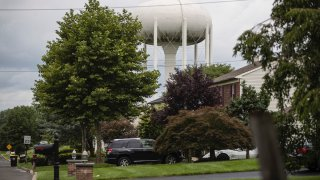 a water tower stands above a residential neighborhood in Horsham, Pa.