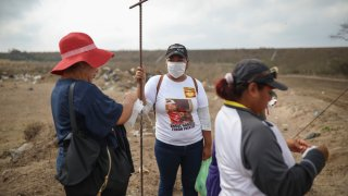 Lidia Lara Tobon, center, whose brother Angel Gabriel Tobon went missing, works with other relatives of the disappeared from the Solecito Collective, as they search for clandestine graves inside a municipal dump