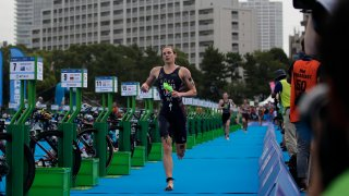 American triathlete Katie Zaferes competes during a women's triathlon test event at Odaiba Marine Park, a venue for marathon swimming and triathlon at the Tokyo 2020 Olympics, Thursday, Aug. 15, 2019, in Tokyo.