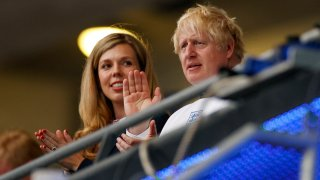 British Prime Minister Boris Johnson and his wife Carrie watch the Euro 2020 soccer championship final
