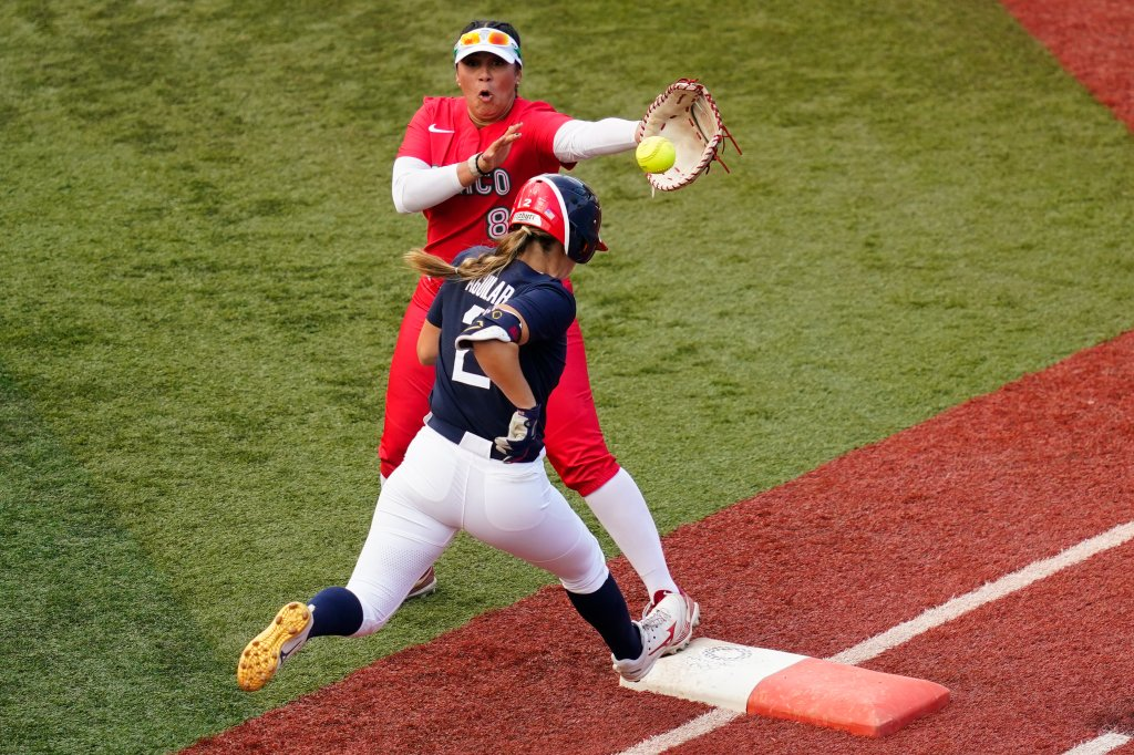 United States' Ali Aguilar (2) reaches first base for a single past Mexico's Victoria Vidales during the sixth inning a softball game at the 2020 Summer Olympics, Saturday, July 24, 2021, in Yokohama, Japan.