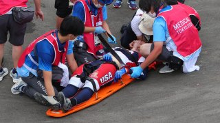 Connor Fields of Team United States in a serious crash is helped by medical staff during the Men's Cycling BMX Racing Semifinal