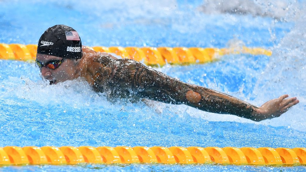 Caeleb Dressel swims the men's 100m butterfly at the Tokyo Olympic Games.