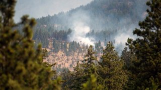 A wildfire burns near Lytton, British Columbia, Canada, on Friday, July 2, 2021. Canadian Prime Minister Justin Trudeau called an emergency meeting of a crisis committee to address the wildfires that are raging through the western part of the country as a heat wave shatters record.
