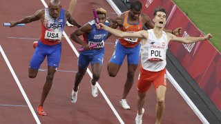 Poland's Kajetan Duszynski, gold medalist, the Netherlands' Ramsey Angela, Dominican Republic's Alexander Ogando, silver medalist, and the USA's Vernon Norwood (R-L), bronze medalist, finish the 4x400m mixed relay athletics final during the 2020 Summer Olympic Games