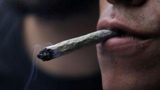 A man smoking joint.