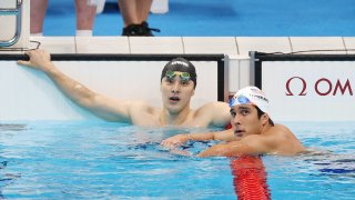 Seto Daiya (left) looks on in disbelief after missing the final of the men's 400m IM. American Jay Litherland (right) successfully advanced.