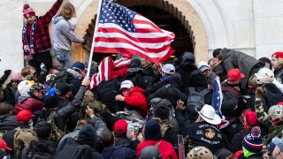 Rioters clash with police trying to enter Capitol building through the front doors, January 6, 2021.