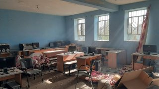 A damaged school is seen after airstrikes in Lashkar Gah city of Helmand province, southern of Kabul, Afghanistan
