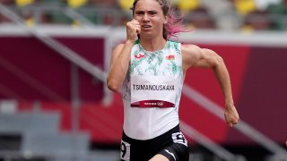 Krystsina Tsimanouskaya, of Belarus, runs in the women's 100-meter run at the 2020 Summer Olympics, Friday, July 30, 2021. Tsimanouskaya alleged her Olympic team tried to remove her from Japan in a dispute that led to a standoff Sunday, Aug. 1, at Tokyo's main airport. An activist group supporting Tsimanouskaya said she believed her life was in danger in Belarus and would seek asylum with the Austrian embassy in Tokyo.