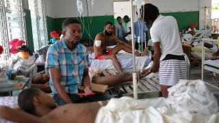 Felix Pierre Genel, 36, whose arm was amputated after he was injured in the earthquake, is treated at the Immaculate Conception Hospital