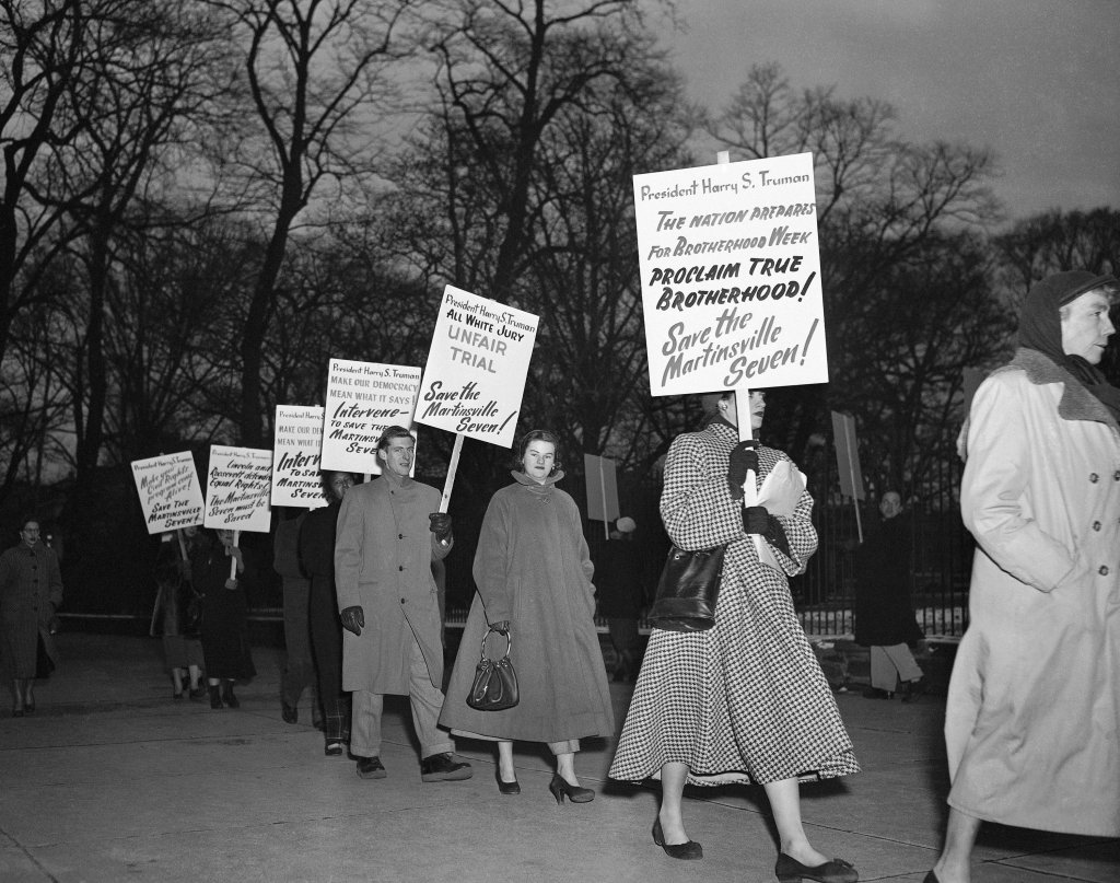 Demonstrators march in front of the White House in Washington, Jan. 30, 1951, in what they said was an effort to persuade President Harry Truman to halt the execution of seven Black men sentenced to death in Virginia on charges of raping a white woman. Virginia Gov. Ralph Northam granted posthumous pardons Tuesday, Aug. 31, 2021 to seven Black men who were executed in 1951.