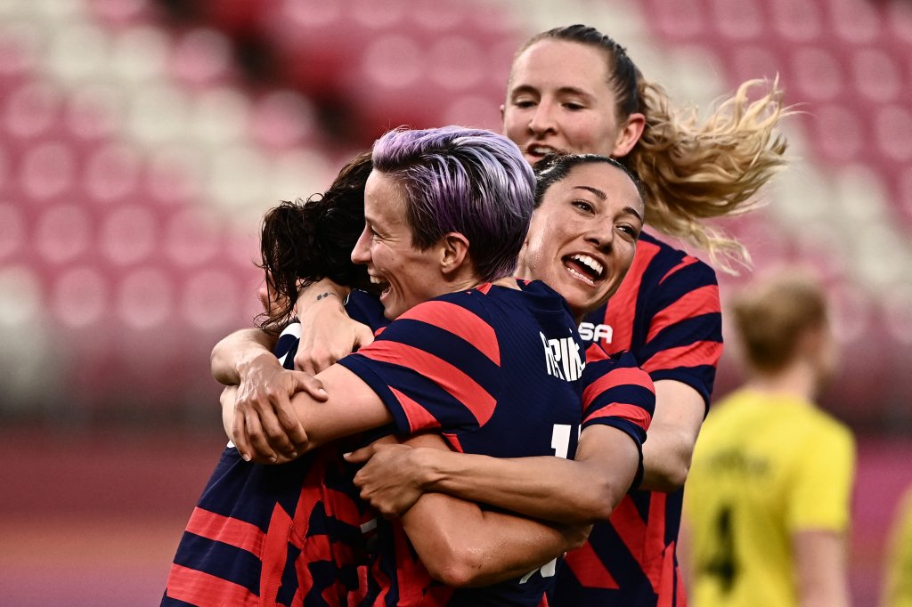 USA's forward Carli Lloyd, left, is congratulated by teammates after scoring during the Tokyo 2020 Olympic Games women's bronze medal football match between Australia and the United States at Ibaraki Kashima Stadium in Kashima city, Ibaraki prefecture on Aug. 5, 2021.