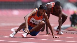 TOKYO, JAPAN - AUGUST 02: Sifan Hassan of Team Netherlands gets back up after falling over Edinah Jebitok of Team Kenya in round one of the Women's 1500m heats on day ten of the Tokyo 2020 Olympic Games at Olympic Stadium on August 02, 2021 in Tokyo, Japan.