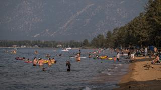 People visit Pope Beach in South Lake Tahoe.