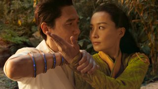 """This image released by Marvel Studios shows Tony Leung, left, and Fala Chen in a scene from """"Shang-Chi and the Legend of the Ten Rings."""""""