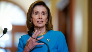 Speaker of the House Nancy Pelosi, D-Calif., talks to reporters as she welcomes Australian Prime Minister Scott Morrison, at the Capitol in Washington, Wednesday, Sept. 22, 2021. The House has approved legislation to fund the government, suspend its borrowing limit and provide federal disaster and refugee aid but Republicans in the Senate are expected to block the measure.