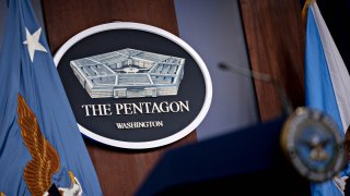 The Pentagon seal in the Pentagon Briefing Room in Arlington, Virginia., U.S., on Wednesday, Sept. 1, 2021. President Biden yesterday declared an end to two decades of U.S. military operations in Afghanistan, offering an impassioned defense of his withdrawal and rejecting criticism that it was mishandled.