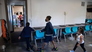 From left, Zihare Wellons, 7, Shahif Wellons, 12, and Janiyah Acie, 3 walk through new Rec2Tech space at Jefferson Recreation Center