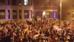 RAW VIDEO: Boston Residents Take to Streets, Sing