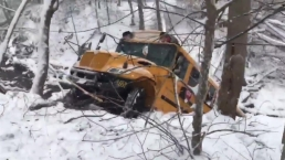 Raw Video: Md. School Bus Slides Into Creek as Snow Begins