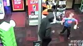Boy Punches Suspect During Armed Robbery at GameStop