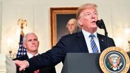 Trump Signs $1.3 Trillion Budget After Threatening Veto