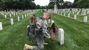 Old Guard Places Flags at Arlington Cemetery Headstones