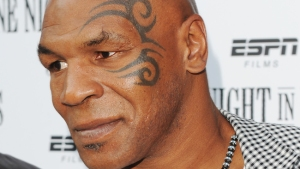 Mike Tyson Helps Motorcyclist After Crash