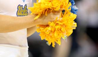Back-to-Back Falls Can't Crush UCLA Cheerleader's Spirit