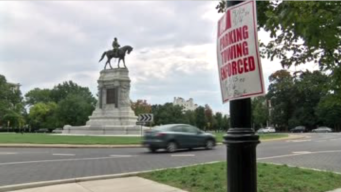 Police Escort Confederate Supporters Away from Lee Statue