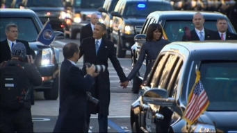 President, First Lady Walk Parade Route
