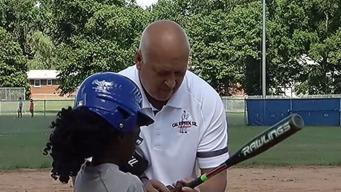 Badges for Baseball: Kids in Prince Georges Practice WIth Cal Ripken