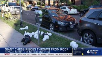 Giant Chess Pieces Tossed From Roof