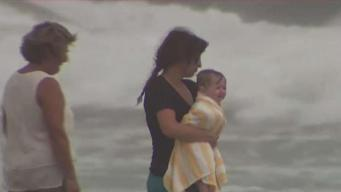 Rough Surf From Florence Draws Spectators in Virginia Beach