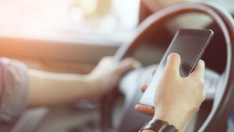 Virginia Moves to Ban Holding Mobile Devices While Driving