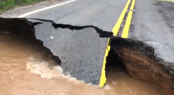 Floodwaters Collapse, Cover Roads in Maryland