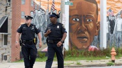 DOJ Report Blasts Baltimore Police Over Bias, Force