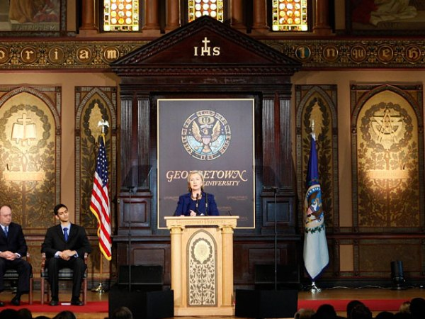 Hillary Clinton in Gaston Hall with Georgetown Senior Jasdeep Singh and Georgetown President John J. DeGioia