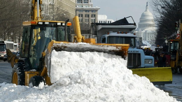 2003: Workers remove snow after one of D.C.'s biggest snowstorms in history, Feb. 15-18, 2003. The storm left more than two feet of snow and shut down the ...