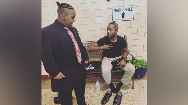 Teacher Gives His Own Shoes to Student to Walk at Graduation