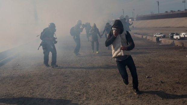 US Agents Fire Tear Gas as Migrants Breach Mexico-US Border