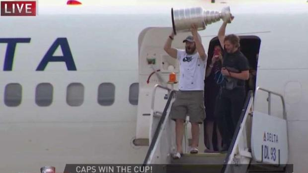 Caps Return to Heroes' Welcome at Dulles, Hoist Stanley Cup