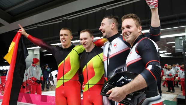 [NATL] Feb. 19 Olympics Highlights in Photos: Germany and Canada Tie for Bobsled Win, France's Wardrobe Malfunction